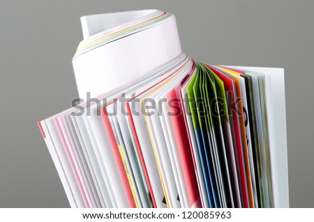 Colorful rolled up magazine with clipping path