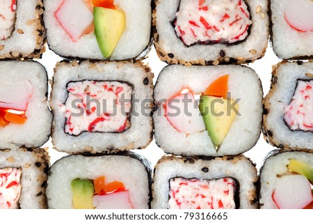 Colorful rolls of sushi including California and surimi rolls made up with crab meat, carrots, avocado, sesame seeds, carrots and rice wrapped in seaweed.
