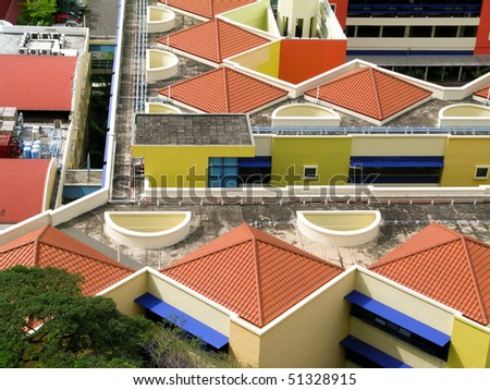 colorful roofs on housing blocks in Singapore - stock photo