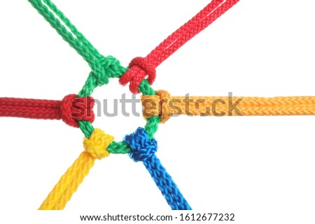 Colorful ropes tied together isolated on white. Unity concept