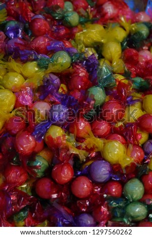 colorful round green bean cake used to used for good treat to children, now they have new role on ritual service table on tet holiday or spiritual events