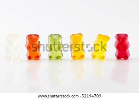 colorful row of jelly bears on white background