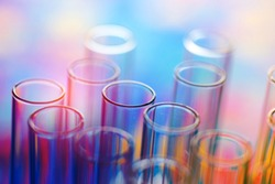 colorful rows of laboratory test tubes , science background