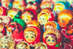 Colorful Russian Nesting Dolls Matreshka At The Market. Matrioshka Babushka Nesting Dolls Are The Most Popular Souvenirs From Russia. Toned instant photo