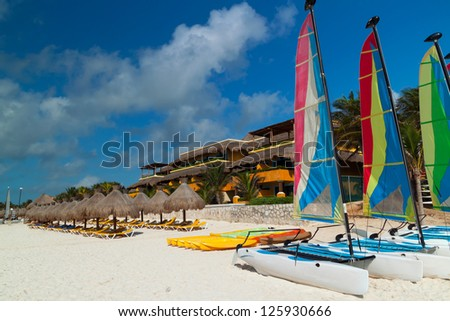 Colorful sail catamarans on the Caribbean beach