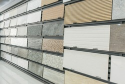 Colorful samples of a stone tile in store. Marble and granite flooring a most popular choice for modern kitchens and bathrooms