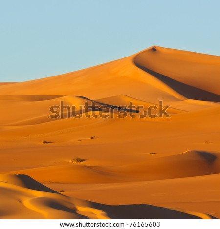 Colorful sand dunes at sunrise - Awbari Sand Sea, Sahara Desert, Libya
