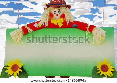 Colorful scarecrow at garden  with banner