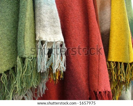 colorful scarfs and plaids hanging
