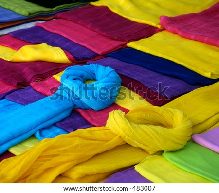 Colorful scarves on market stall