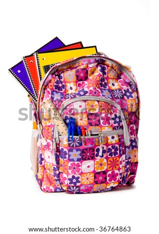 Colorful school back pack overflowing with school supplies including pens, pencils. tablets, notebooks, and books