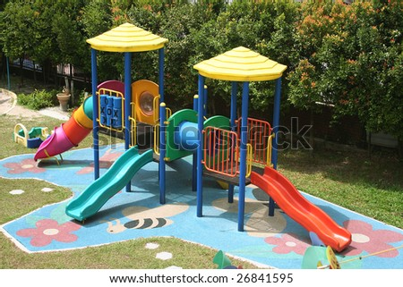 Colorful school playground with slides and toys on a sunny day
