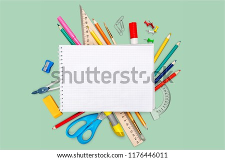 Colorful school supplies on white background #1176446011