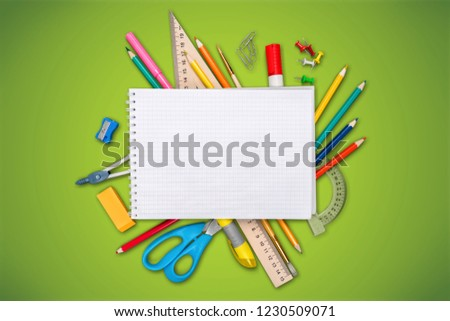 Colorful school supplies on white background #1230509071