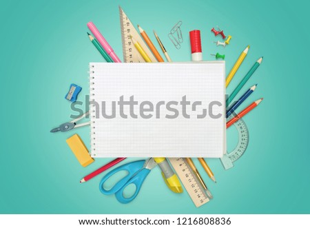 Colorful school supplies on wooden background #1216808836