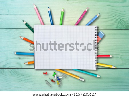 Colorful school supplies on wooden table background #1157203627