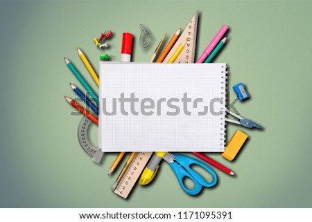 Colorful school supplies on wooden table background #1171095391