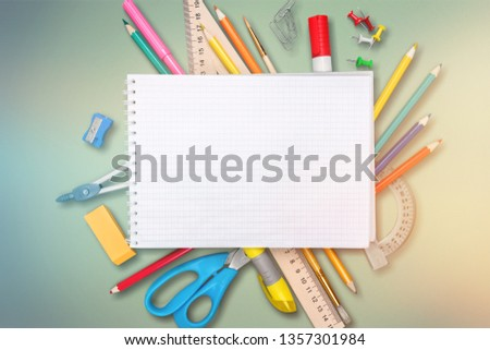 Colorful school supplies on wooden table background #1357301984