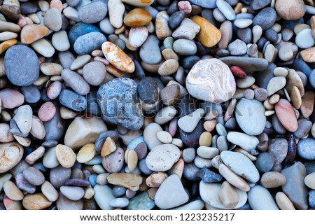 Colorful sea pebbles. Background of sea pebbles. Multicolored stones. Pebble texture. #1223235217