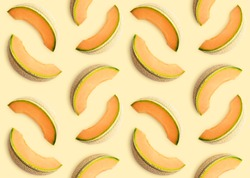 Colorful seamles fruit pattern of melon slices on yellow background. Top view. Flat lay