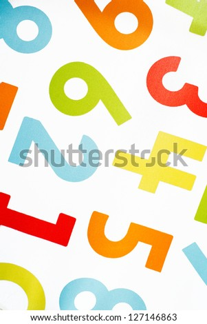 Colorful sew on numbers on white material