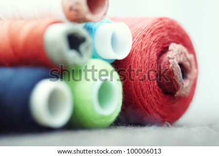 Colorful sewing spools. Macro colorful photo - stock photo