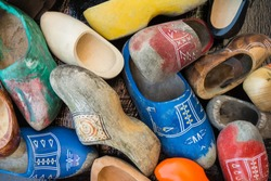 Colorful shabby clogs (traditional wooden dutch shoes). Top view, close-up