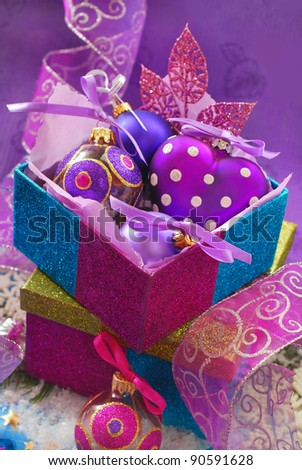 colorful shining gift boxes with beautiful christmas baubles - stock photo