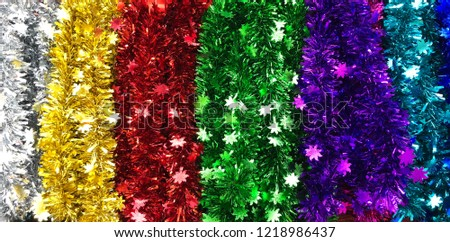 Colorful shining tinsel garland background #1218986437
