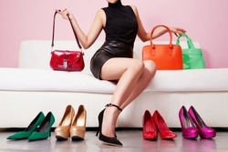 Colorful shoes and bags with woman sitting on the sofa. Shopping and fashion images.