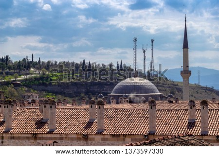 Colorful shoot of old moslem theological school roof with layers of hills in Safranbolu #1373597330