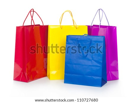 Colorful shopping bags in row isolated on white