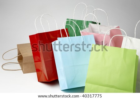 colorful shopping bags shot on soft white background