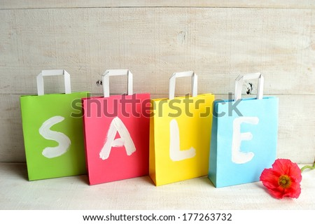 Colorful shopping paper bags with red poppy.image of bargain sale on spring season