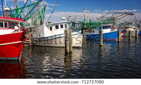 Colorful shrimp fishing boats docked in harbor at Biloxi, Mississippi