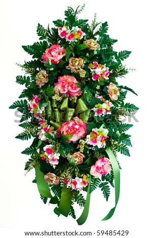 Colorful silk flower wreath arrangement isolated on white - stock photo