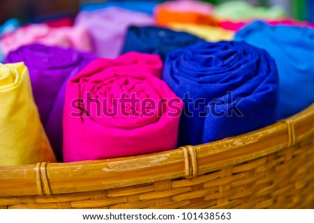 Colorful silk rolled and keep in the basket