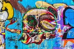Colorful skull. Street art graffiti. Closeup painted wall of the city.