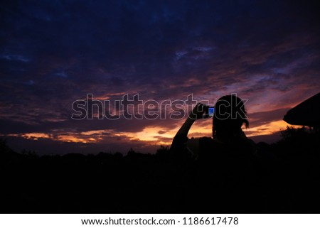 Colorful sky in twilight time background, Twilight sky with cloud and silhouette of girl take picture. #1186617478