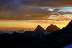 Colorful sky sunset in mountains silhouette, Fann, Pamir Alay, Tajikistan