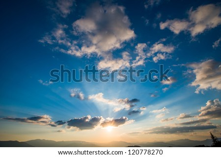 colorful sky with sun background in mountains. sunset, sunrise. #120778270