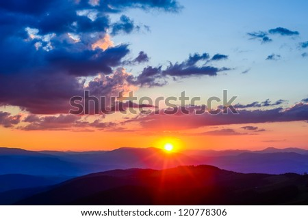 colorful sky with sun background in mountains. sunset, sunrise.