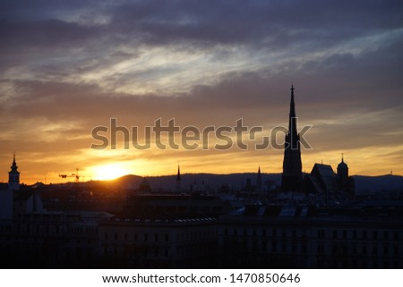 Colorful skyline at sunset with ancient European buildings and churches
