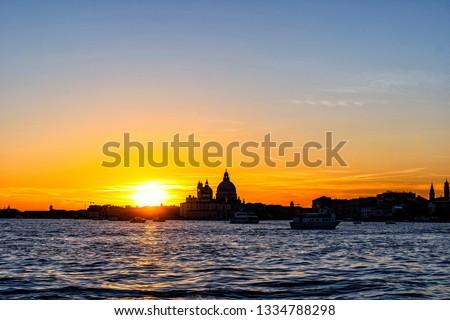 Colorful  skyline of Venice, Italy at sunset. Beautiful sunet behind Basilica Santa Maria della Salut.