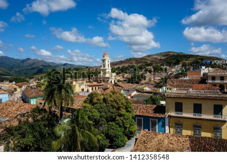 Colorful skyline with mountains and colonial houses. The village is a Unesco World Heritage and major tourist landmark on the Caribbean Island, Trinidad de Cuba