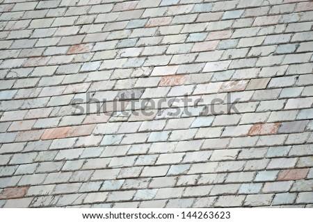 Colorful slate shingles on a sunny rooftop