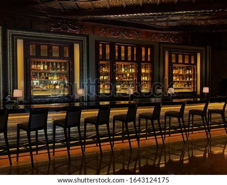 Colorful, Sleek Jazz Bar With Rows of Bar Stools; Empty Bar, Social Distancing