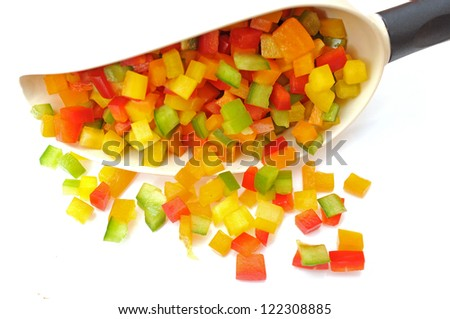 colorful sliced bell peppers on white background - stock photo