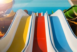 Colorful slides in water park on sunny day
