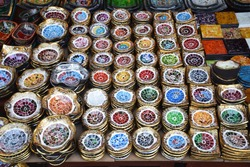Colorful small plates in a souvenir shop in Ubud market, Bali - Indonesia
